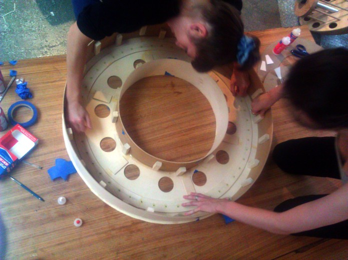 Marina and Jenny create the delicate inner structure of the harp resonator.