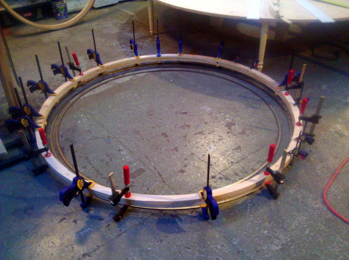 Gluing the rings.  Or a wooden particle accelerator.